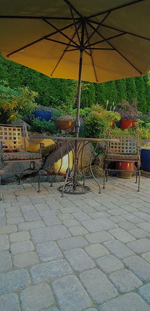 pavers with umbrella and chairs